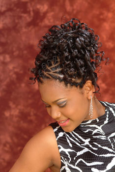 Model Looking down to the Right: Updo With Beautiful Curls Black Hairstyles for Little Girls