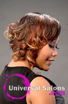 Paulette Edwards' Medium Hairstyle with Hair Color and Curls
