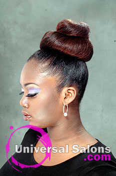 Pamela Webster's Blow Out Silking with a Bun Hairstyle