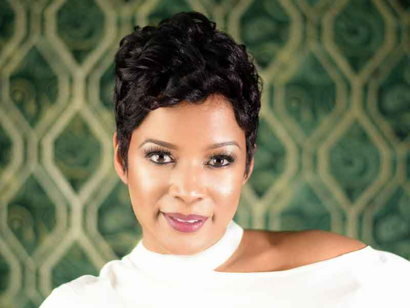Check Out This Short Hairstyle with Curls from Nette Mayfield