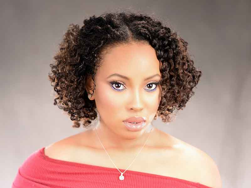 Naturally Curly Hairstyle with Highlights from Terrisina Jackson