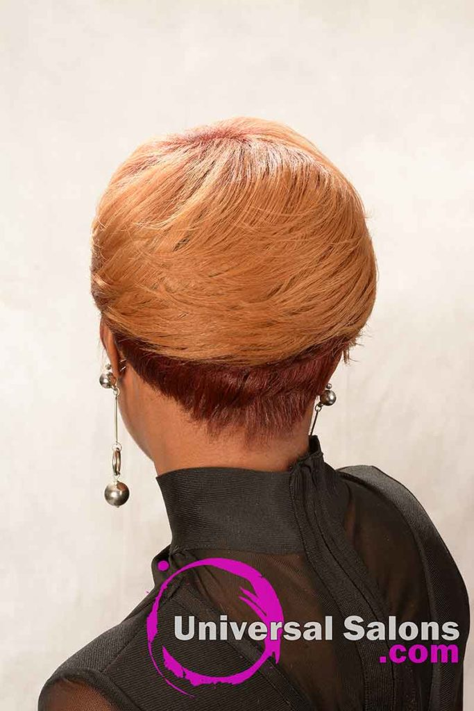 Back View: Short Hairstyle for Black Women with Layers and a Feathered Bang