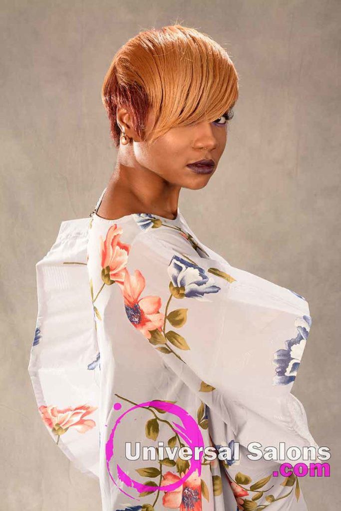 Short Hairstyle with Honey Blonde Hair Color and a Feathered Bang