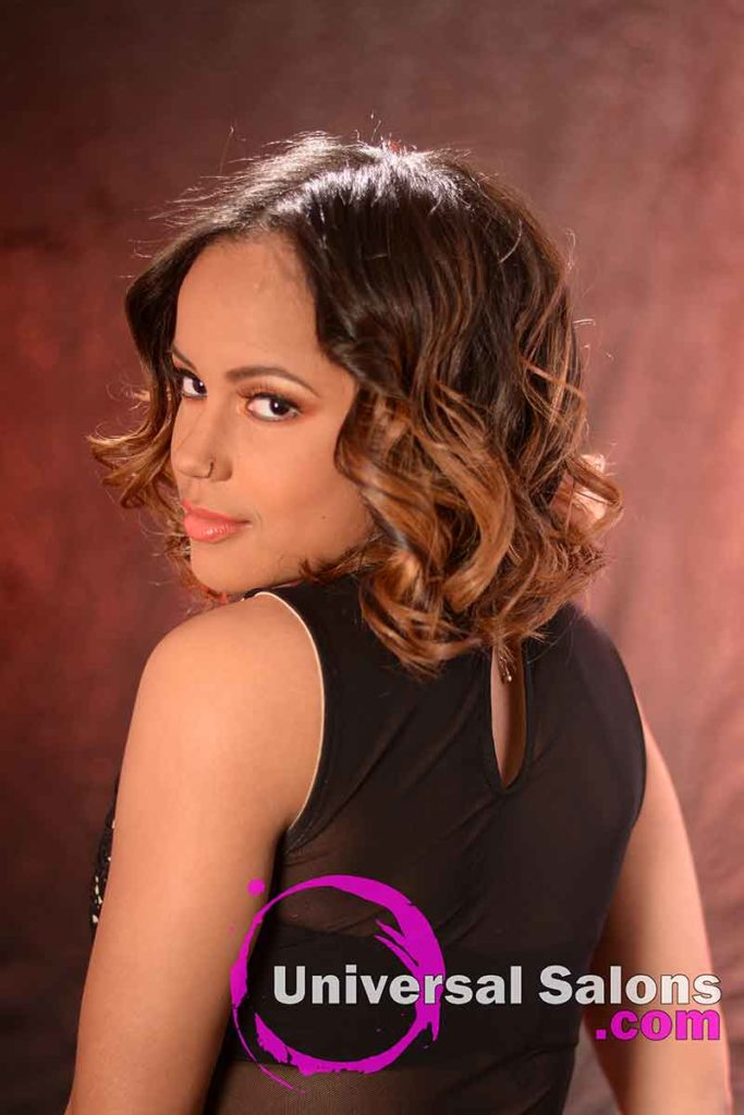 Back Left View: Medium Length Curly Bob Hairstyle with Highlights