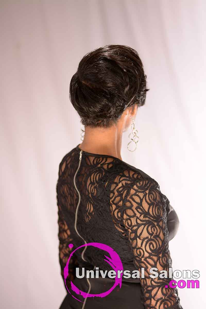 The back of this short hairstyle has soft curls and layers in the top