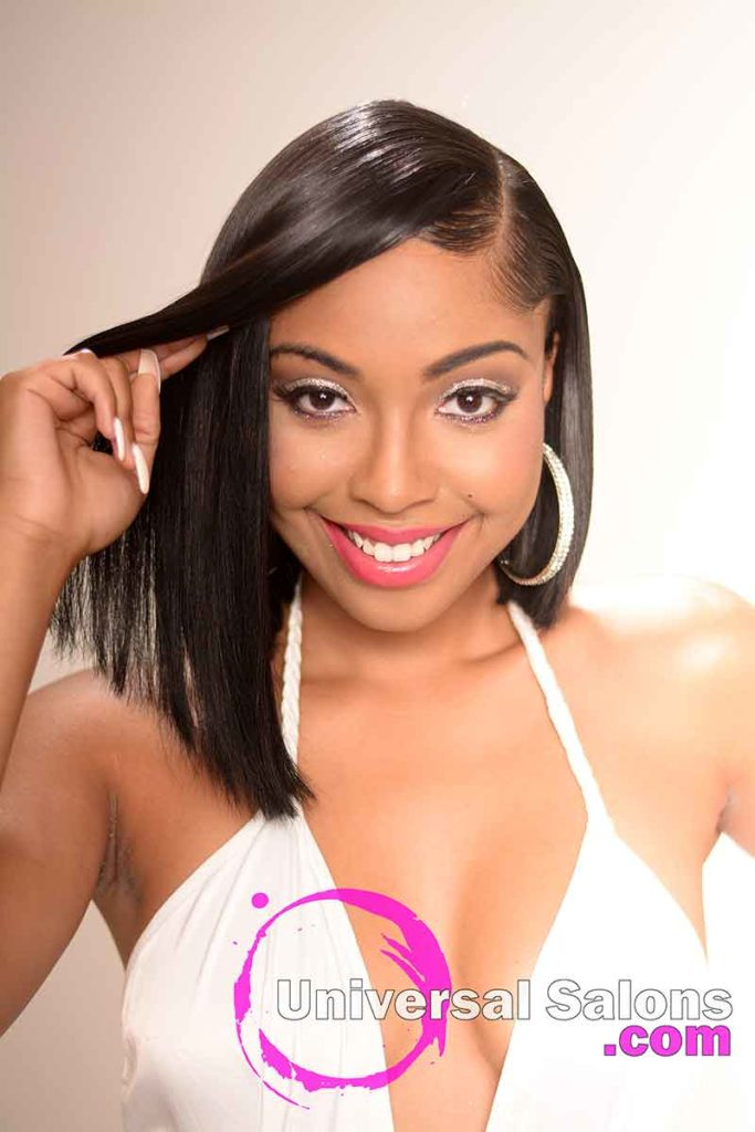 Model Sweeping the Sew In Bob Hairstyle Away from Her Eye