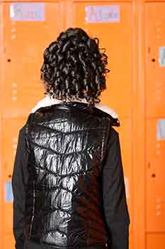 Back View: Model in Front of Lockers wearing Curly Bob Hairstyle