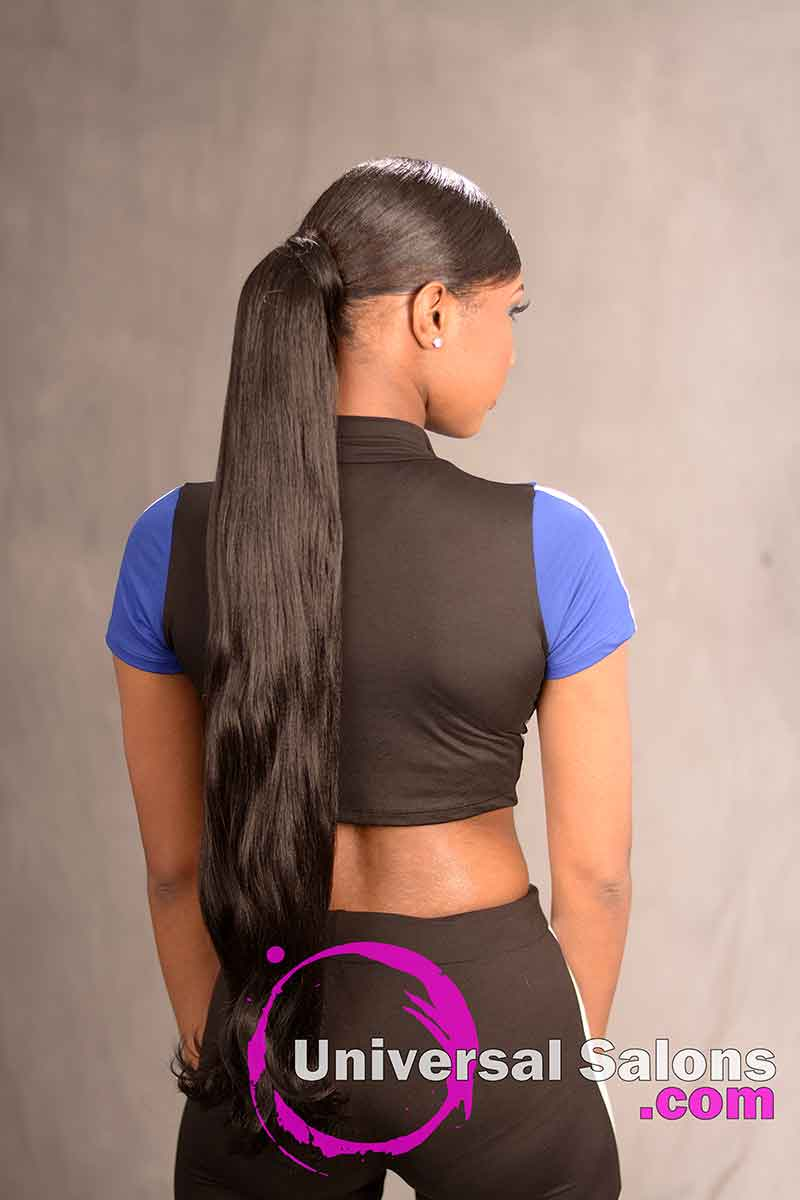 The Back View of a Deep Side Part Ponytail Hairstyle