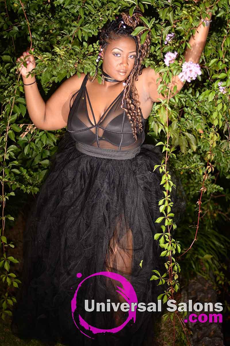 Model in Greenery Wearing a Goddess Locks Updo Hairstyle