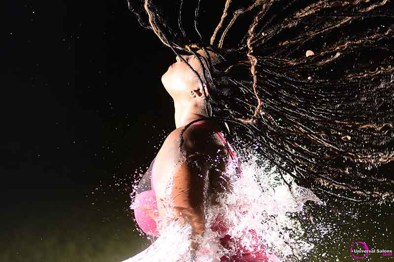 Model Splashed With Water Wearing Long Goddess Locks Hairstyle With Accents