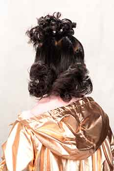 Back View: Model With a Curly Bun Hairstyle
