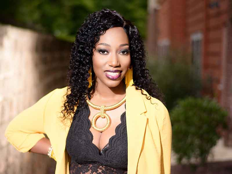 Long Curly Sew-In Hairstyle for Black Women