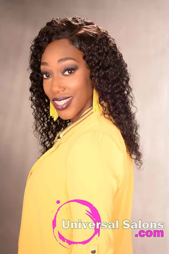 Side View of a Long Curly Sew-In Hairstyle for Black Women