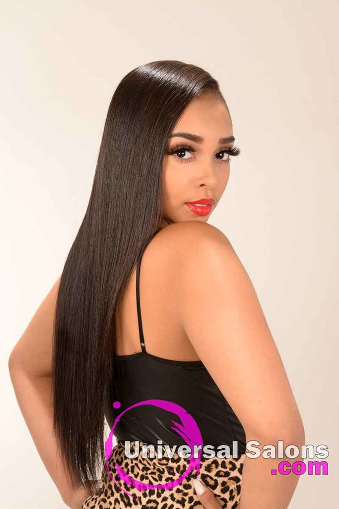 Model Looking Over the Shoulder With Long Silk Press Hairstyle