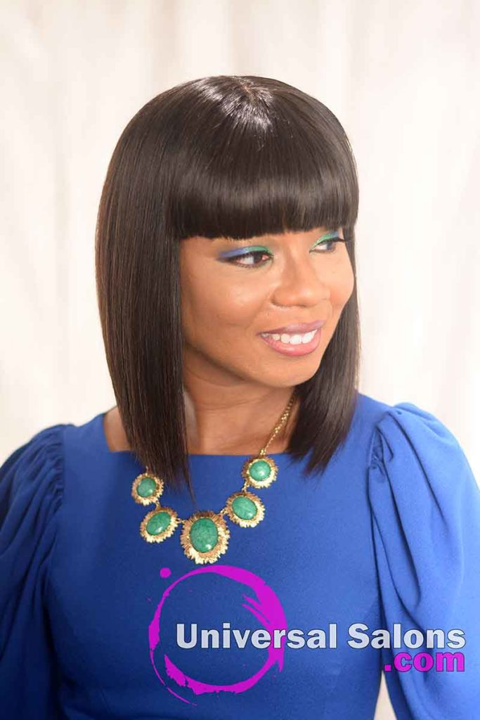 Asymmetrical Bob Hairstyle for Black Women With a Chinese Bang