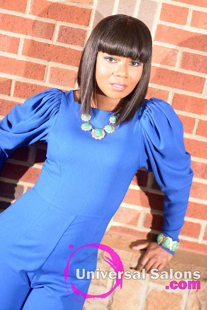 Model Leaning Against the Wall With an Asymmetrical Bob Hairstyle