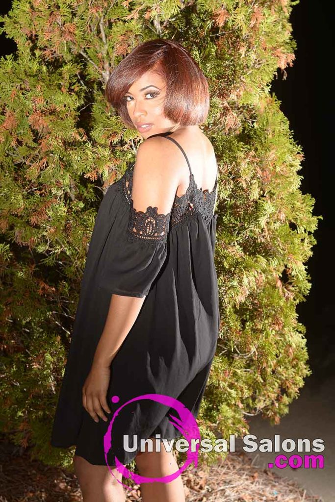 Model Looking Over Shoulder With Natural Hair and Color