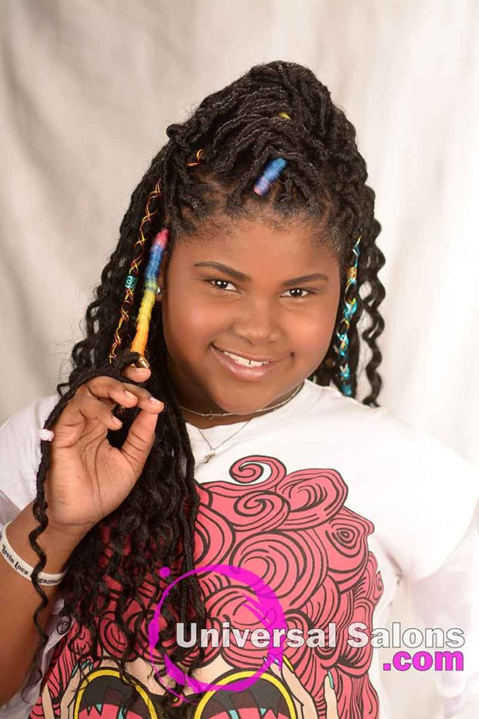 Faux Locs Model With Her Finger in Her Hair
