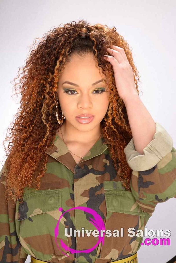 Model With Hands in Hair With Bohemian Curls Sew-In Hairstyle