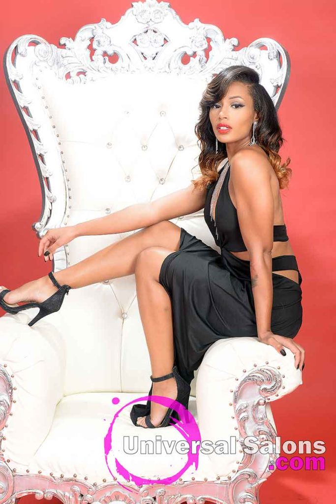 Model Stradled Across Chair With Long Hair Additions