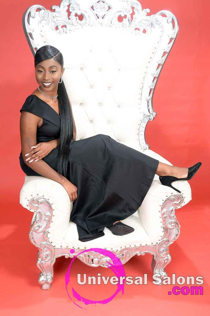 Long Hair Model Sitting in Large Chair