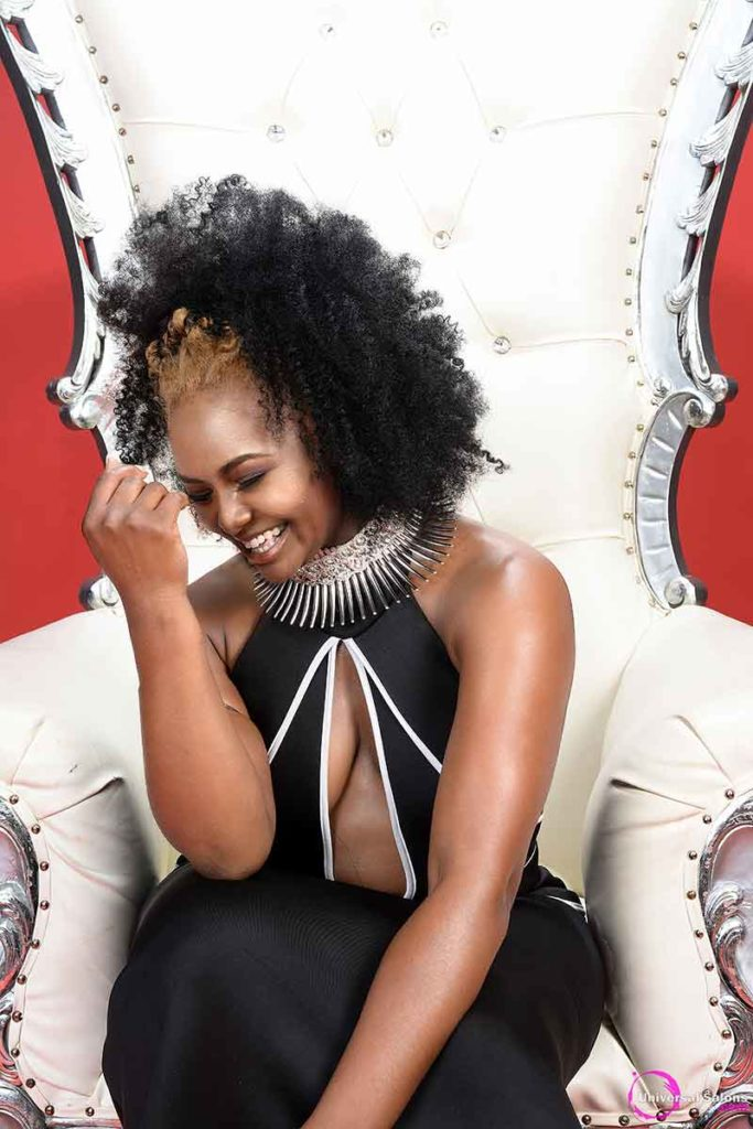 Model Laughing Wearing Two-Strand Twists Black Hairstyle