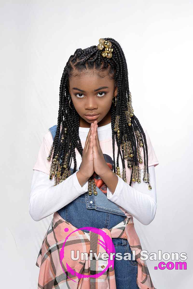 Kid With Hands Together Waring Knotless Braids