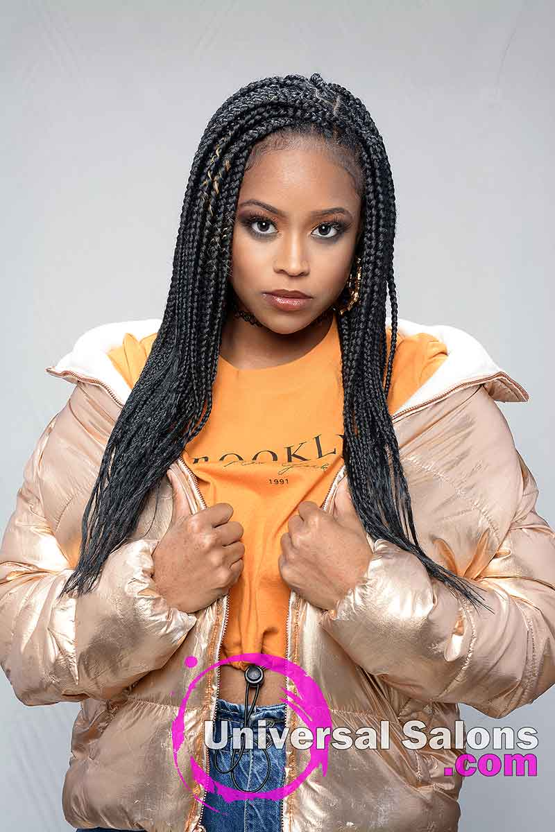 Model Holding Jacket With Long Knotless Box Braids