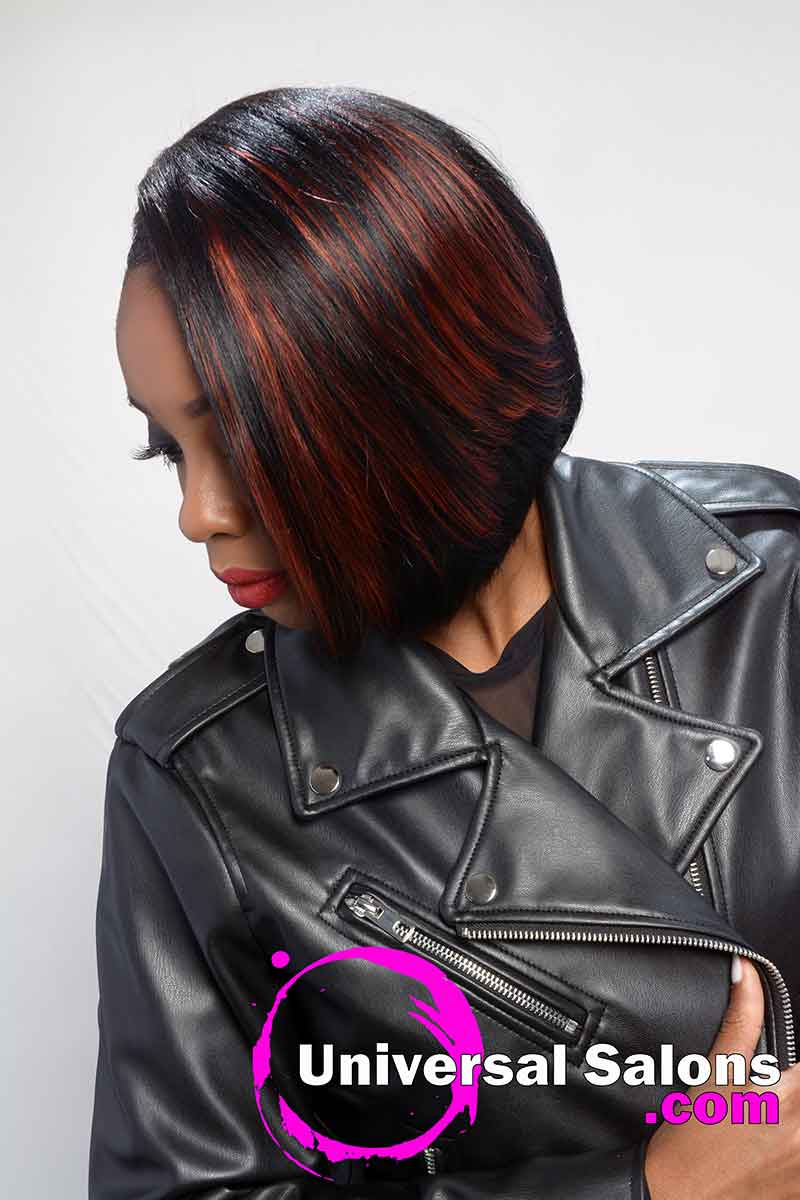 Model Looking Down With Short Quick Weave Bob Hairstyle
