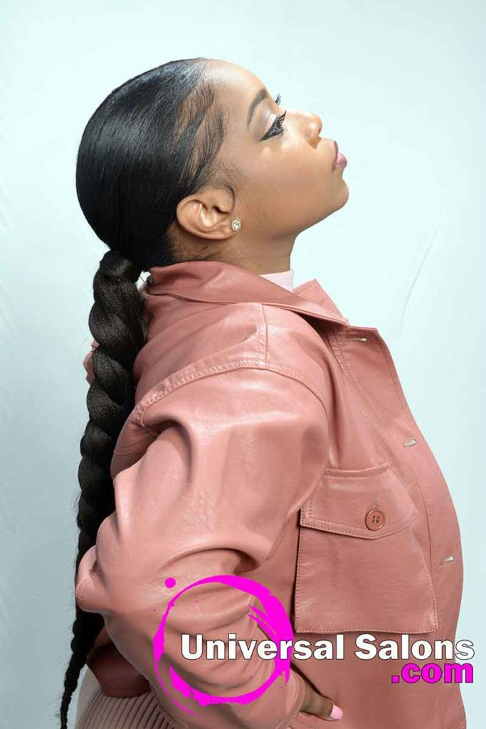 Side View Of Sleek Ponytail Model Looking Up