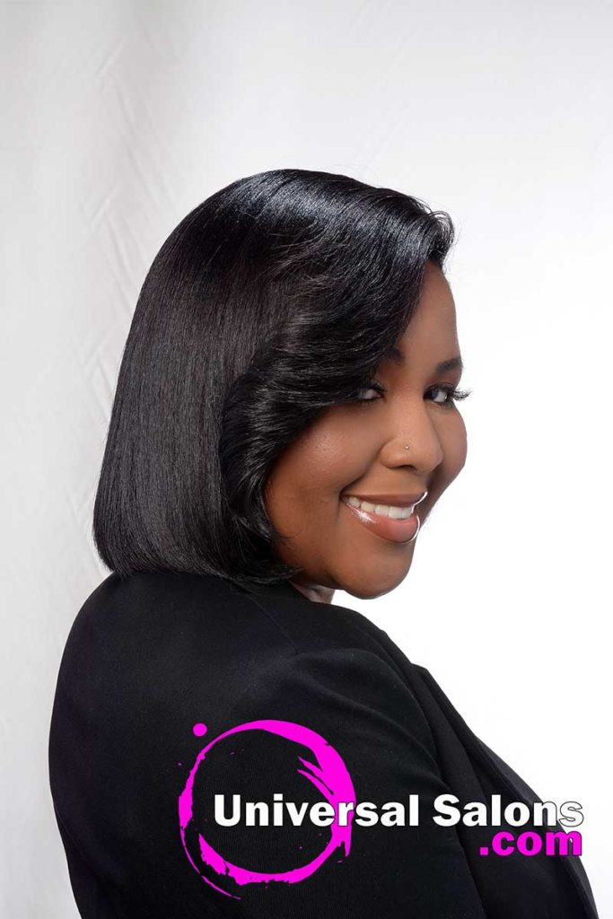 Model With Soft Curls Asymmetrical Bob on Natural Hair